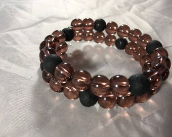Purple beaded bracelet with lava rock