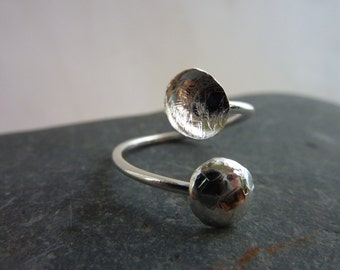 Adjustable ring with hammered sterling silver domes: Handmade sterling silver.  One size fits all UK size I-Q/US 4.75-8.5