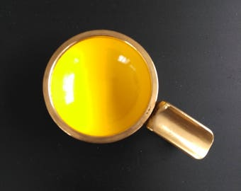 Vintage yellow enameled brass ashtray