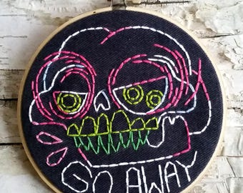 "pink & green GO AWAY skull - 5"" hand embroidered wall hanging"