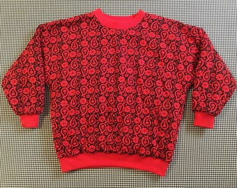 1980's, puffy, quilted pullover, in red and black, paisley print, Women's size Medium