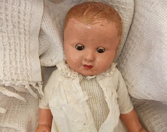 Early 1920,s Vintage Composition Baby Doll with  worn period antique dress