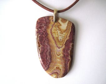 Fabulous wonderstone pendant on brown leather necklace