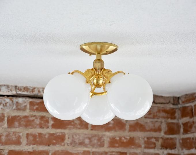 Palmdale Semi Flush [Raw Brass - Mid Century - Modern - Industrial - 3 Globe - 3 Light - Opal - Glass Globe - UL Listed]
