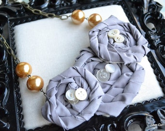 tattered grey fabric flower rosettes, Mother of Pearl vintage buttons, glass pearls and chain necklace