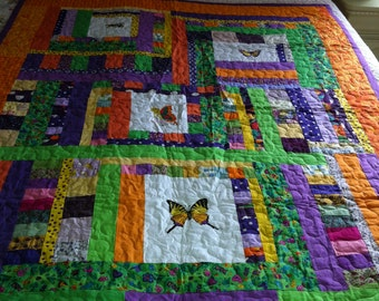 Multi colored butterfly and insect  quilt