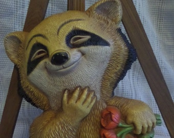Vintage plastic happy raccoon wall decoration 1977