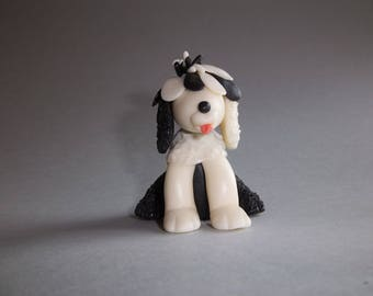 decorative object or dog paperweight made of cold porcelain