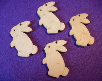 4 rabbits, wood, 4.5 x 3.5 cm  (10-0004C)