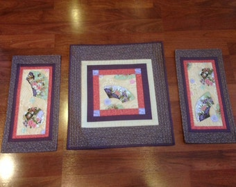 Asian inspired set of hand crafted quilted wall hangings includes fans, cherry blossoms and combs