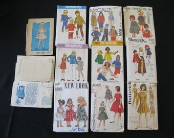Lot of 11 Retro Girl's Patterns in sizes 3 - 8, grab bag lot with patterns NOT examined for completeness, dates from 1950's thru 1990's