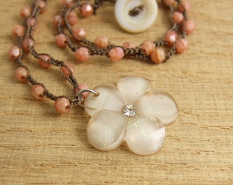 Crocheted Necklace with a Brown Cord, Coral Pink Colored Czech Glass Beads, and a Cream Flower Pendant SN-397