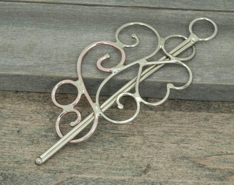 Metal hair slide or hair barrette hair accessories swirly with a heart