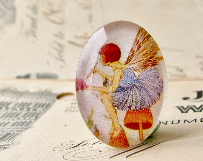 Fairy painting the flowers, handmade 25x18mm oval glass cabochon, fantasy stories, children illustration, from our Winged Wonders collection