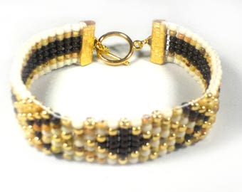 White, gold and brown bracelet,   bead woven with arrow designs