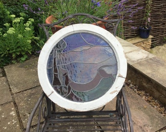 A Vintage Circular Stained Glass Window