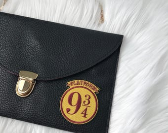 leather envelope clutch with patch / wizard train