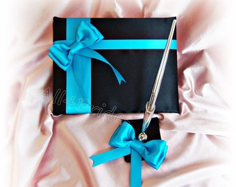 Black and turquoise wedding guest book and pen set.