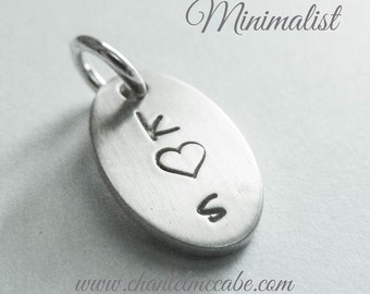 Personalised mini charm oval pendant in Argentium sterling silver, customised Minimalist pendant only. Perth, Western Australia