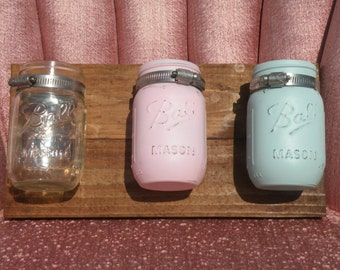 Set of 3 mason jars attached to wooden plank
