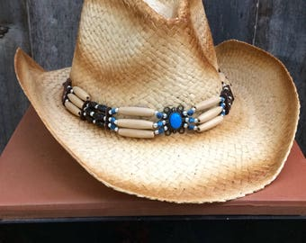 Brown and Tan Straw Cowboy Hat Vintage Look with Blue, Tan, Black and Silver Beads with a Medallion on Front with a Blue Stone Center.