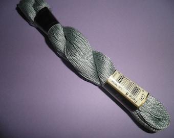 In 25 grams size 5 DMC Perle cotton: ref 927 (green)