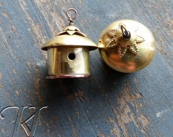 A pair of little handmade  brass and copper birdhouses