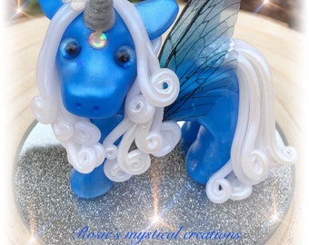 Polymer clay unicorn with wings