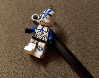 Hairstick with mini action figure