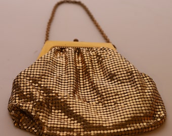 Whiting and Davis mesh bag in gold.