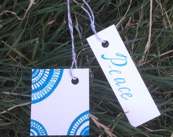 Blue PEACE and STARS gift tags. Hand-illustrated gift tags. Hand-written gift tags. Birthday gift tags. Blue ink. Peace. Stars.