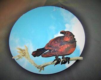 merle sur sa branche , cuir repoussé sur miroir