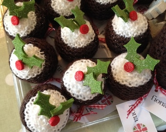Christmas puddings hand knitted with a Ferraro Rocher inside