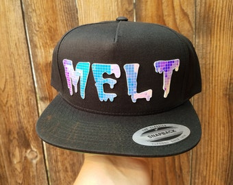Melt Flat Brim Hat in Black, Red, or Heather Grey with Super Reflective Writing and Snap Back Fit