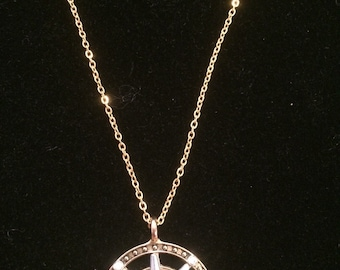Gold colored compass necklace
