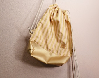 Golden Sneak bag made of cotton and vegan leather
