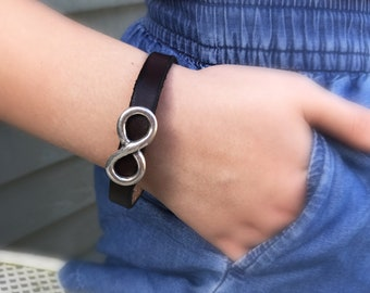 Leather bracelet with silver 'Infinity' concho ornament