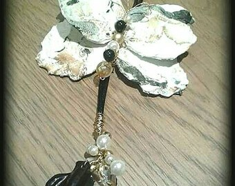 Long Necklace marbled Butterfly pendant white and black in the art of recycling plastics.