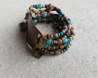 Copper Wrist Plate Bracelet with Multi Strand Brown Turquoise Orange Blue Green Tan Wood Glass Jasper Beads Antique Brass Charms