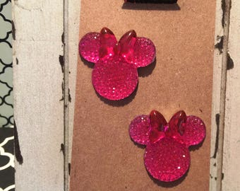 Simply the cutest sparkly Minnie Mouse earrings on nickel free posts.  Overall length is 1""