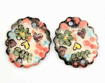 A pair of Catrina skull connectors, rustic, black, white, colorful, enameled, ceramic component for jewelry, bead art, pottery, ethnic, ooak