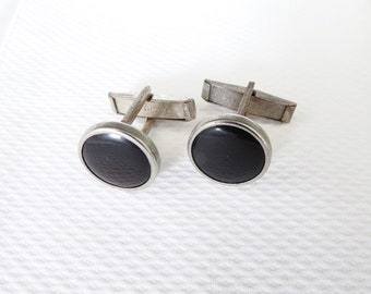 Vintage silver tone metal cufflinks with black onyx inserts
