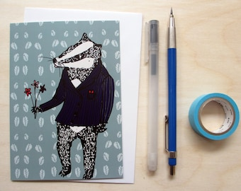 Greetings card 'Bob the Badger' A6 Digitally printed. Featuring an illustration of a badger in a suit with a bunch of flowers.