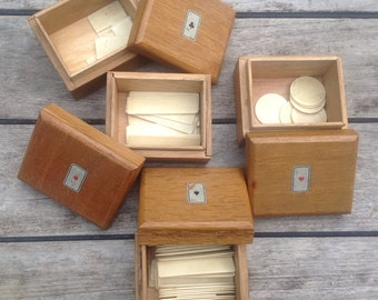 Set of 4 wooden boxes with bone tokens