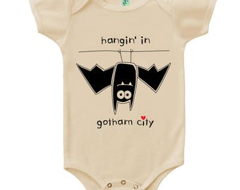 Organic cotton short sleeve baby one piece with screen printed hanging in gotham city bat design by Bugged Out, made in the USA