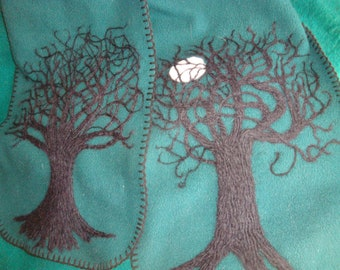 green polyester scarf with black tree on each end, and one moon
