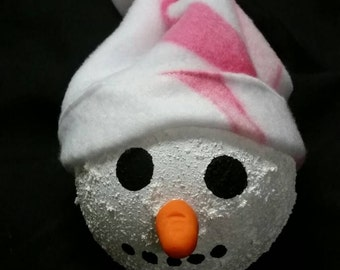 An adorable textured painted snow person ornament in a Breast cancer awareness print fleece