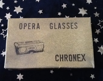 Chronex opera glasses in original box.