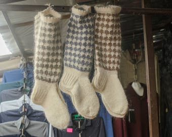 Knitted knee socks of natural sheep's wool