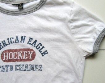 Vintage American Eagle Outfitters T-Shirt - AEO, Hockey State Champs, Sports T-shirt, White and gray T-shirt, 100% Cotton, Size small, 1970s